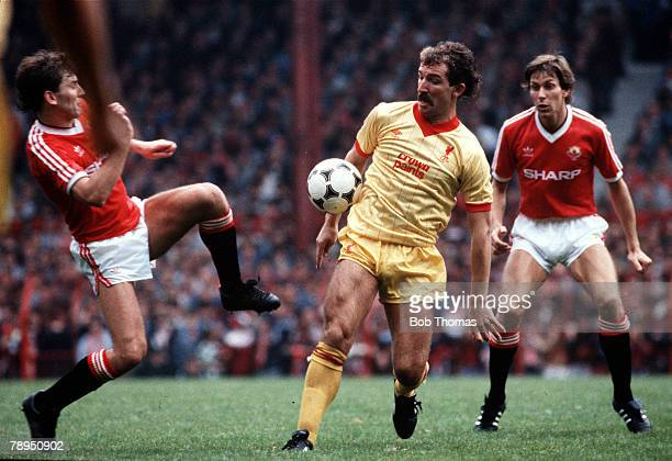 Old Trafford Manchester Manchester United v Liverpool Liverpool's Graeme Souness is challenged by Manchester United's Bryan Robson as Arnold Muhren...