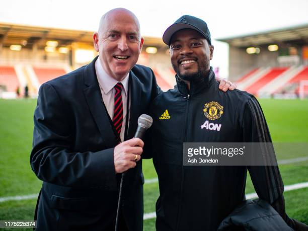 Old Trafford stadium announcer Alan Keegan poses with Patrice Evra ahead of the Barclays FA Women's Super League match between Manchester United and...