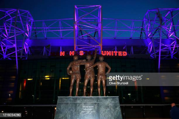 Old Trafford the home of Manchester United Football Club displays an NHS UNITED logo on the front entrance of the stadium tonight to honour the Clap...