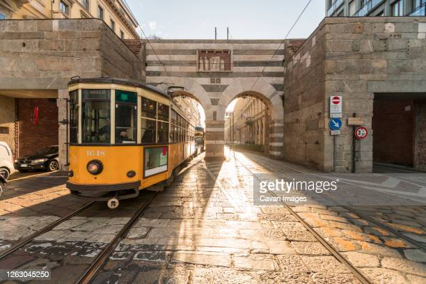 old tram at archi di porta nuova, alessandro mansioni street in milano - milan stock pictures, royalty-free photos & images