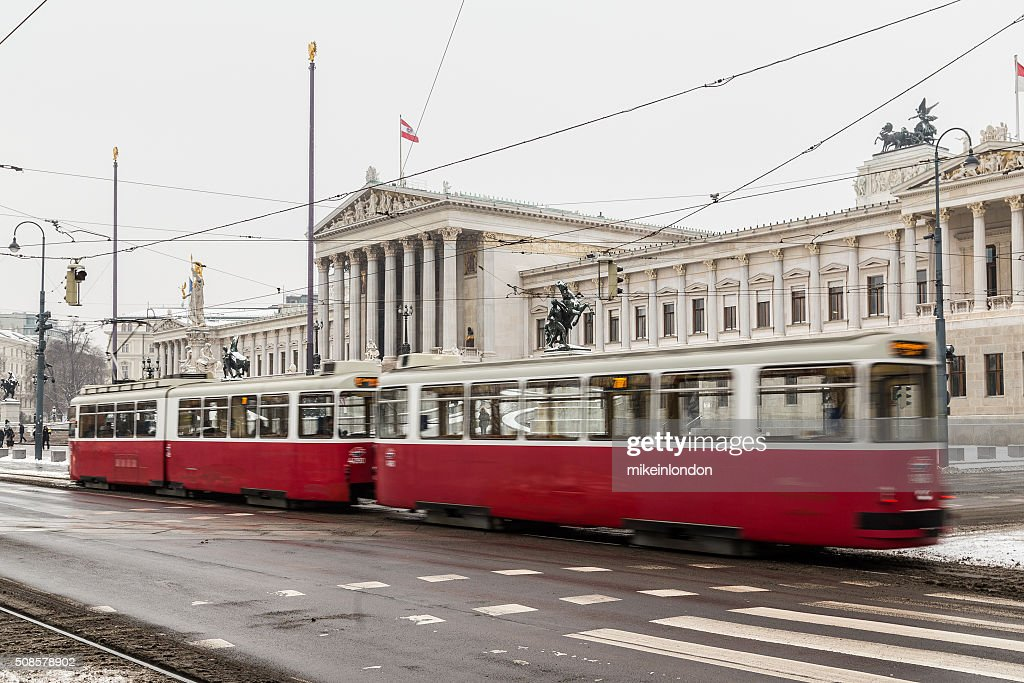 Old Trams and Austrian Parliament : Stock Photo