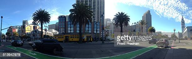 Old trolley car and the Embarcadero clock tower in downtown San Francisco California