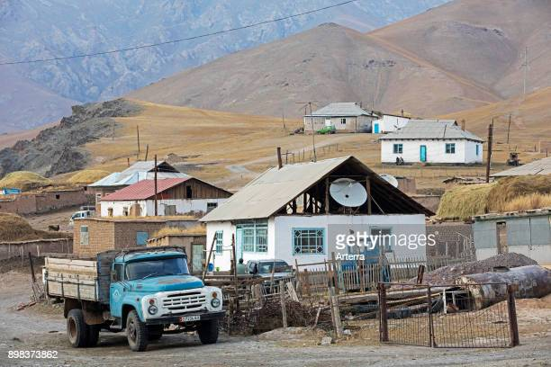 Old truck and houses in the small rural village SaryTash in the Alay Valley of Osh Region Kyrgyzstan