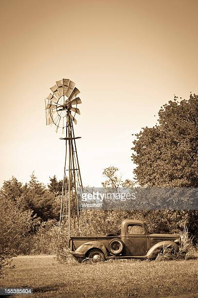 old truck and windmill - old windmill stock photos and pictures