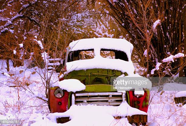 Old truck in snow near Chimayo, New Mexico.