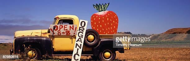 old truck with giant strawberry - timothy hearsum bildbanksfoton och bilder