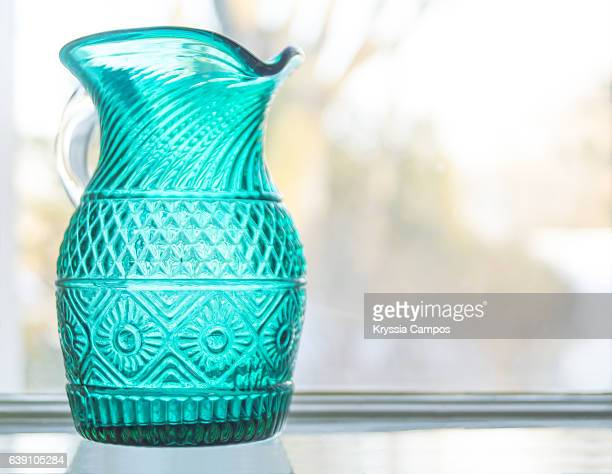 Old Turquoise Bottle on a window sill