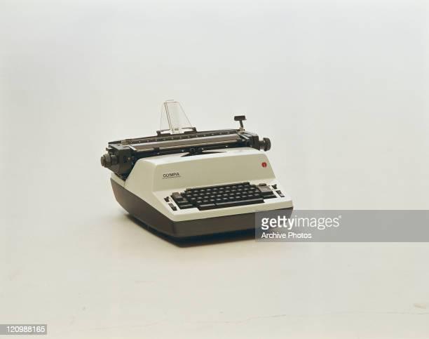 Old type writer on white background