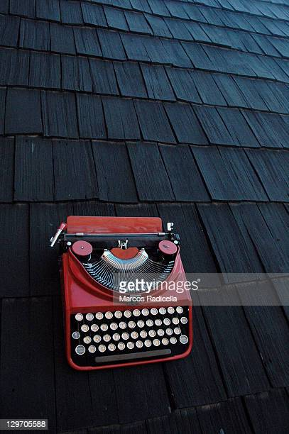 old typewriter on rooftops - radicella stock pictures, royalty-free photos & images