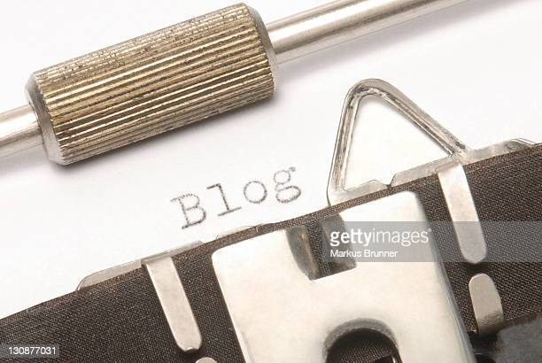 old typewriter with the word blog - captions stock photos and pictures