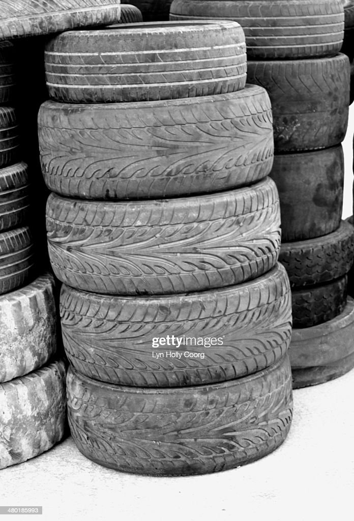 Old tyres stacked up in a pile : Stock Photo