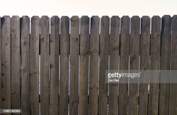 old unpainted wooden picket fence against white background - 杭垣 ストックフォトと画像