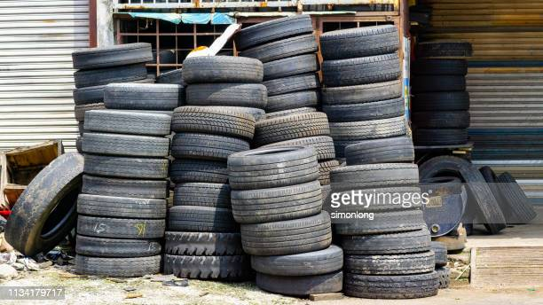 old used car tires at outdoor - obsolete stock pictures, royalty-free photos & images