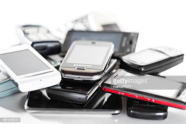 old used cellphones pile - obsolete stock pictures, royalty-free photos & images