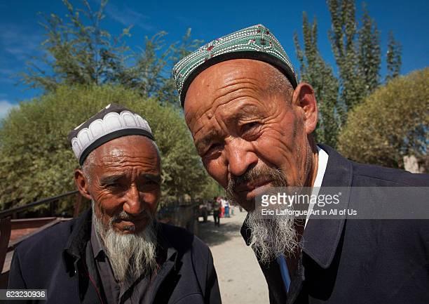 Old Uyghur men in Serik Buya market Yarkand Xinjiang Uyghur Autonomous Region China on September 20 2012 in Yarkand China
