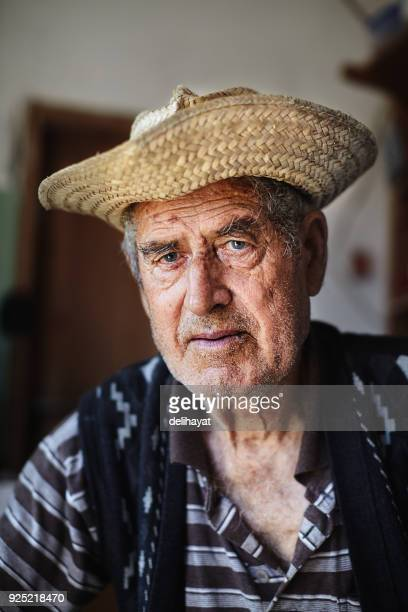 old varmer with straw hat - one senior man only stock pictures, royalty-free photos & images