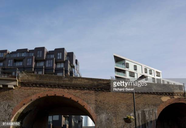 Old Victorian railway bridge and new housing in the borough of Southwark on 30th January 2018 in London England