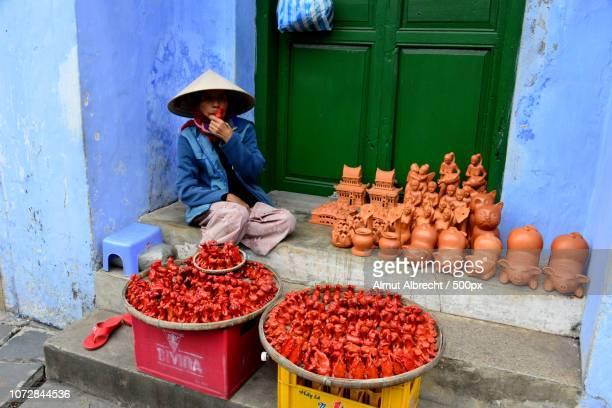 old vietnamese woman sells whistles
