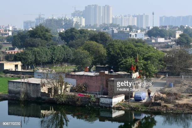 Old village on the construction site in Noida short for the New Okhla Industrial Development Authority It is an extension of Delhi the capital of...