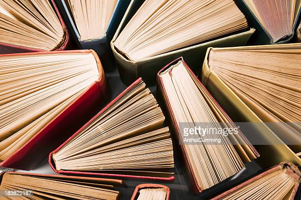 old vintage books slightly fanned open from above - spelling stock pictures, royalty-free photos & images