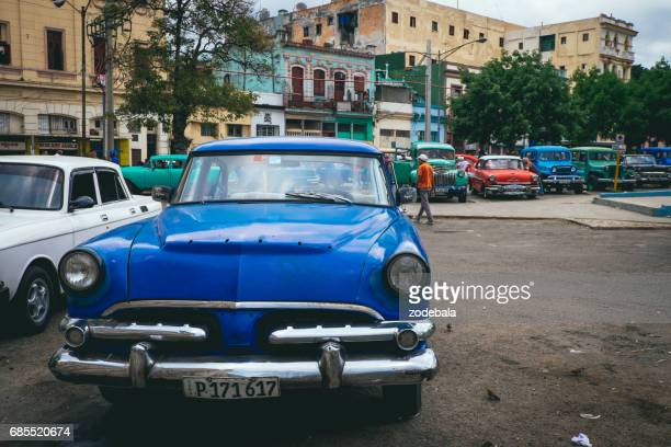 old vintage car in a parking lot of havana, cuba - tropical music stock photos and pictures