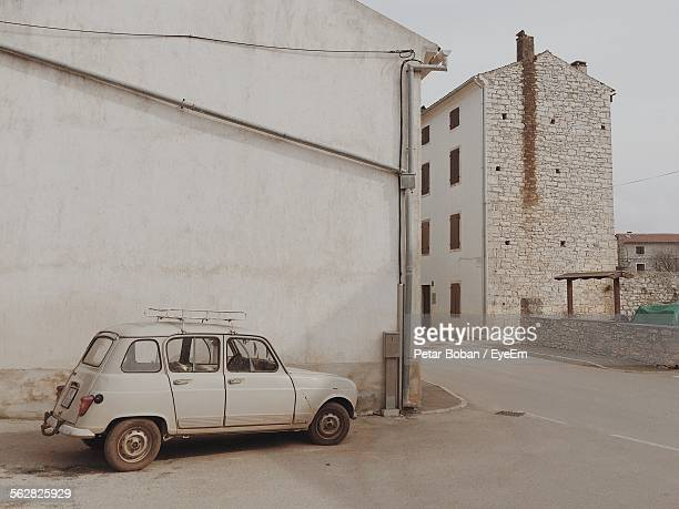 old vintage car parked by building - boban stock pictures, royalty-free photos & images