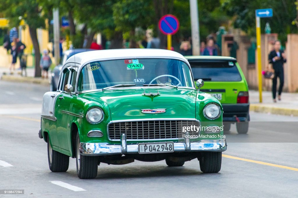 Old vintage cars in action  The green Chevrolet drives in