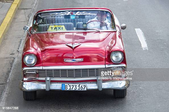 Old vintage cars in action  The red convertible Chevrolet drives in