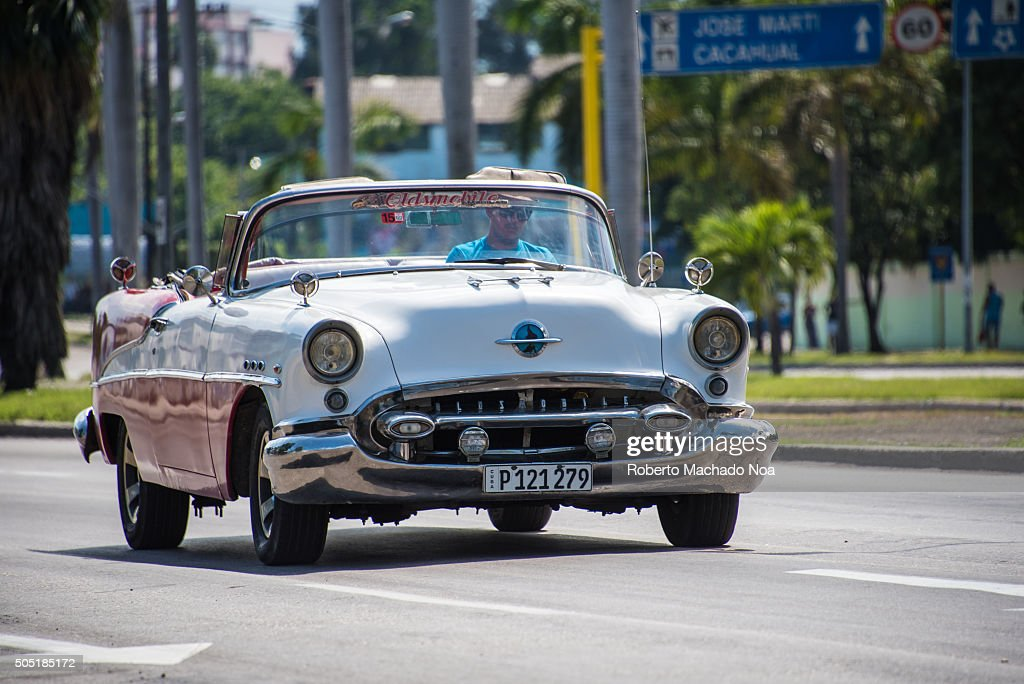 Old vintage cars vehicles in moving action Havana,Cuba. The ...