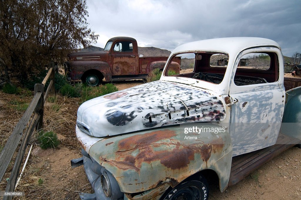 Old vintage pickup trucks along the Route 66 at the general store of ...
