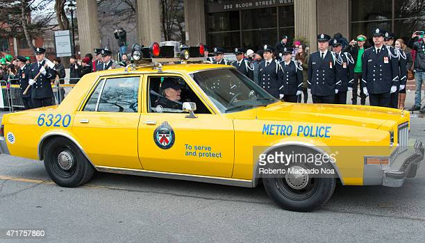 TORONTO TORONTO ONTARIO CANADA Old vintage police car part of Toronto police heritage partaking in the St Patrick's Day parademulticultural Toronto...