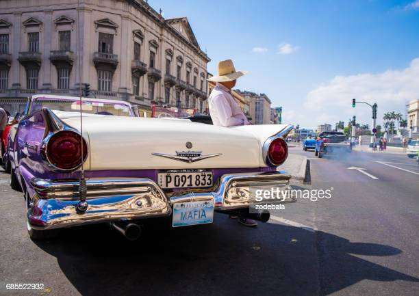 old vintage taxi car in the city center of havana, cuba - tropical music stock photos and pictures