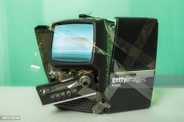 Old vintage TV fixed with duct tape and still working