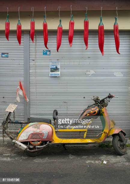 Old vintage yellow scooter parked Bali island Denpasar Indonesia on July 20 2015 in Denpasar Indonesia