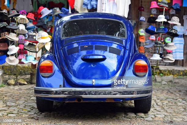 old volkswagen beetle on the bazaar - beetle stock pictures, royalty-free photos & images