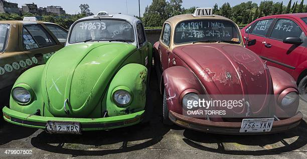 Old VW Beetle cars remain in a large lot for impounded cars due to unpaid fines in Mexico City on June 23 2015 AFP PHOTO/OMAR TORRES