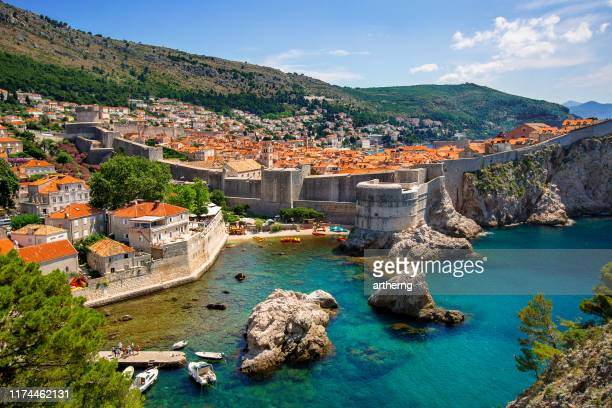 old walled city of dubrovnik and the adriatic sea, croatia - fortified wall stock photos and pictures