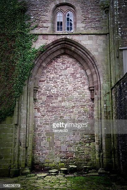 old walled up stone doorway at llanthony priory, wales - terryfic3d bildbanksfoton och bilder