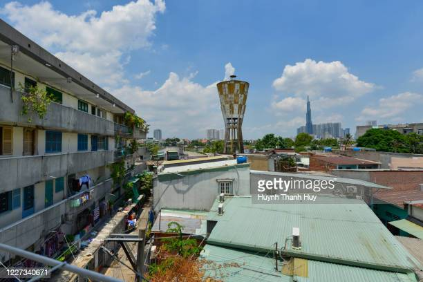 old water tower and landmark 81 building from the old apartment - saigon river stock pictures, royalty-free photos & images