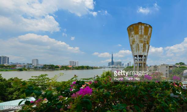 old water tower and landmark 81 building - saigon river stock pictures, royalty-free photos & images