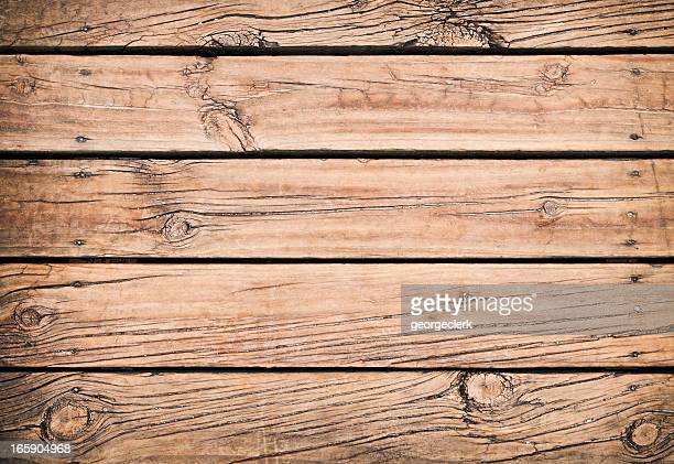 old weathered wooden floorboards - floorboard stock photos and pictures