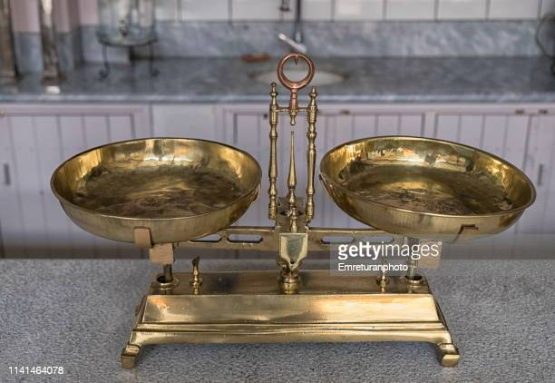 Old weighing scale on a marble stand.
