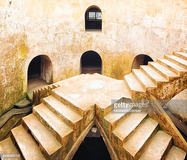 Old well at Yogyakarta Water Castle with four staircases