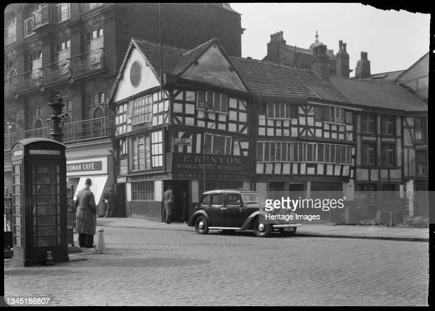 Old Wellington Inn, Old Shambles, Manchester, 1942. An exterior view of the Old Wellington Inn, showing the front facade in Old Shambles. The former...