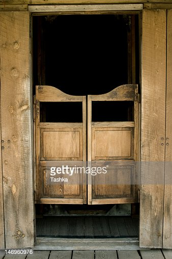 Old West Style Saloon Doors And Frame With Black Background Stock Photo  Getty Images