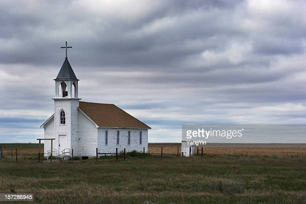 old white wooden church in rural field scene with storm - church stock pictures, royalty-free photos & images