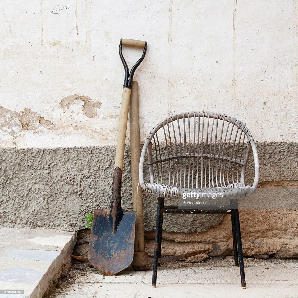 Old Wicker (rattan) Chair, Spade And Pickaxe : Stock Photo