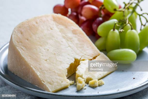 Old Winchester firm pasteurized cheese from Lyburn Farm in the New Forest UK stands in this arranged photograph in London UK on Monday July 24 2017...
