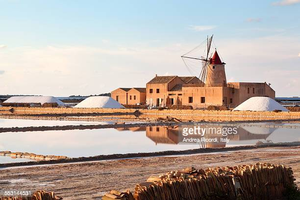 old windmill at marsala salt pans - marsala sicily stock pictures, royalty-free photos & images