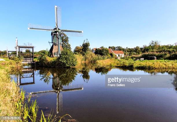 old windmill in the village of tienhoven, netherlands - frans sellies stockfoto's en -beelden